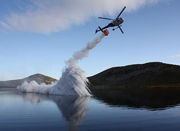 Helicopter aerial spreading of fertiliser and lime